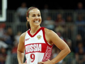 Russia's Hammon smiles toward her bench during the women's preliminary round Group B basketball match against Brazil at the Basketball Arena during the London 2012 Olympic Games